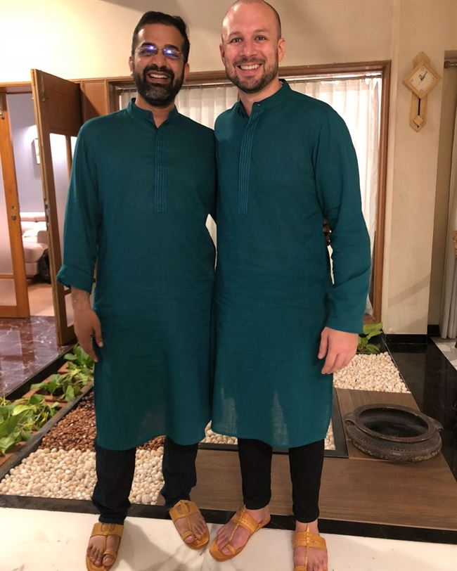 With Rahul Jain, CEO of Brain & Co. in traditional dress.